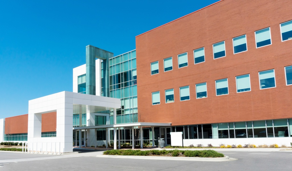 Building Industries served by MiTek - The exterior of a healthcare medical building with drive-up overhang