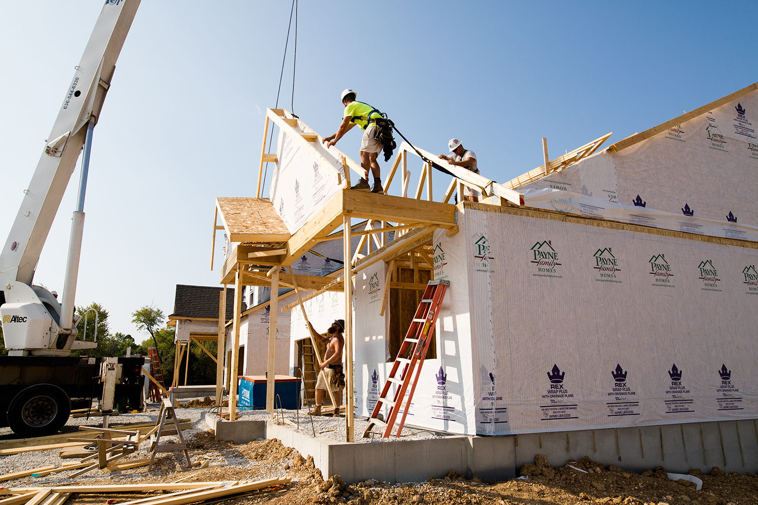 Homebuilding Solutions Press Release by MiTek - View of a wooden truss being installed in a residential, single-family home