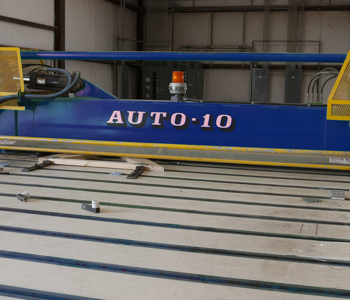 Auto-10 Platen Press Automated Solutions - Auto-10 Platen press in use in warehouse