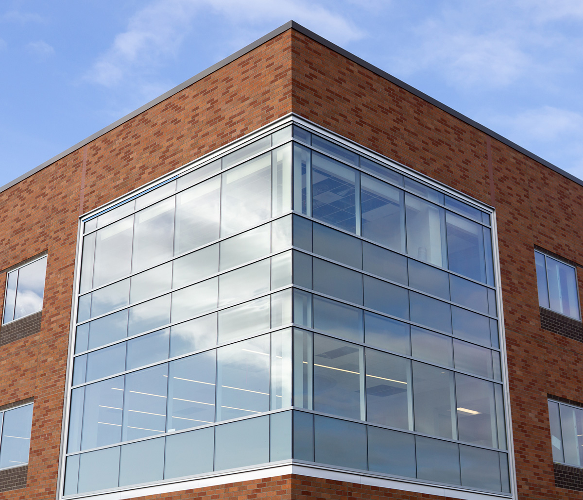 Benson Glass Engineered Systems Products - Corner of a brick and class building