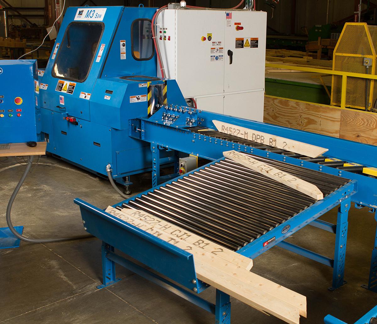 MiTek Blade Screwed Conveyor Automated Solutions - Blew Screwed conveyor in warehouse facility
