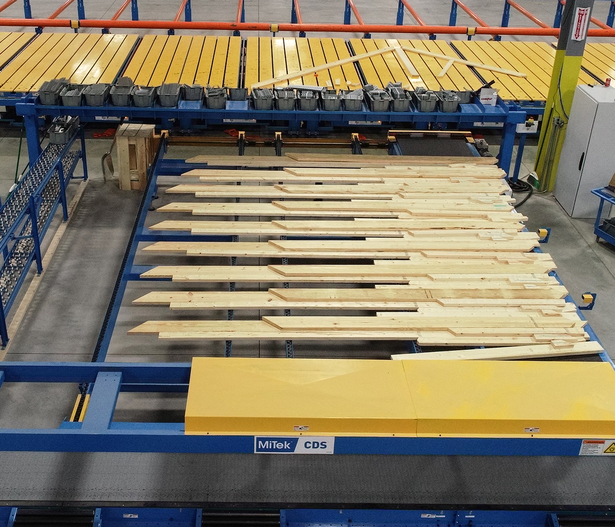 MiTek Component Delivery System Automated Solutions - Component delivery system in use moving lumber in warehouse