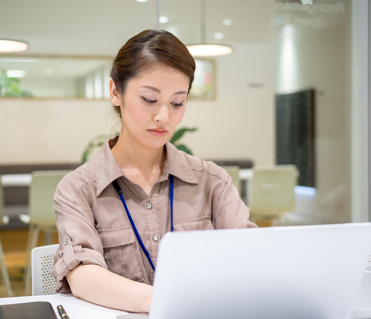 MiTek Data Entry Administration Services - Woman and man in office handing paperwork