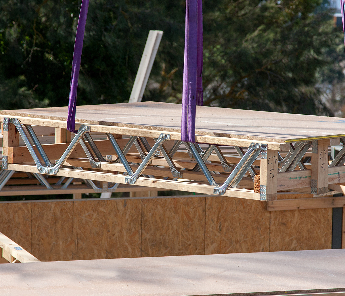 MiTek Floor Cassettes Engineered Systems Products - Wooden floor cassettes being hoisted into construction site