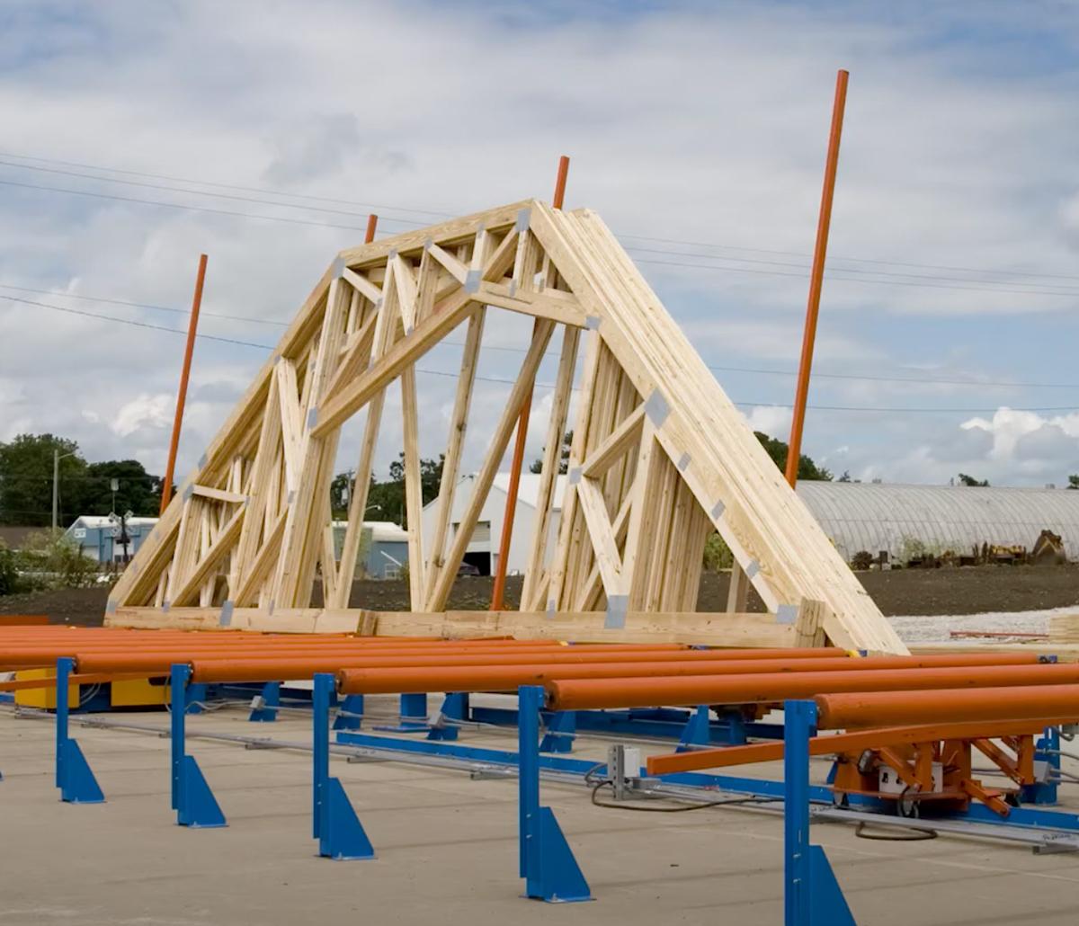 MiTek Peak Up Stacker Automated Solutions - Peak trusses being stacked