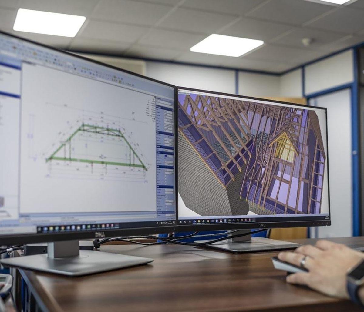 MiTek Prefabrication Component Design Services - Person sitting at desk with computer working on design software