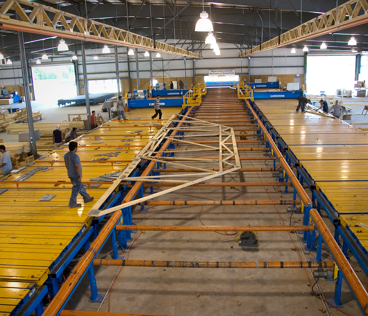 MiTek Stand Alone Conveyor Automated Solutions - Team working on stand-alone conveyor