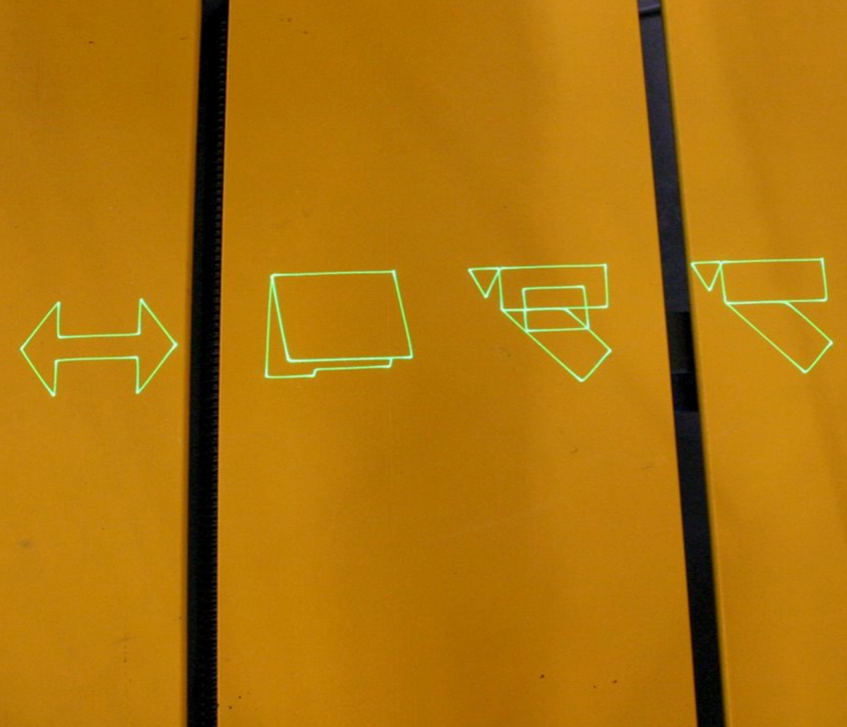 MiTek Virtek Trussline Automated Solutions - Arrow, folder, and shapes projected onto a yellow background